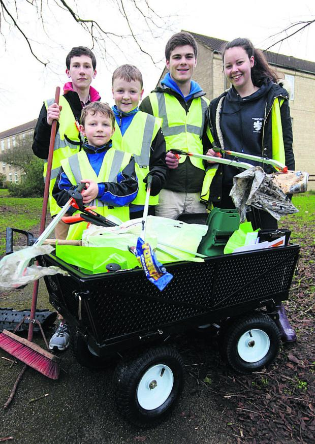 This Is Wiltshire: Young residents of Charter Road were out in force to help with the clean-up day, organised by Sovereign Housing Association