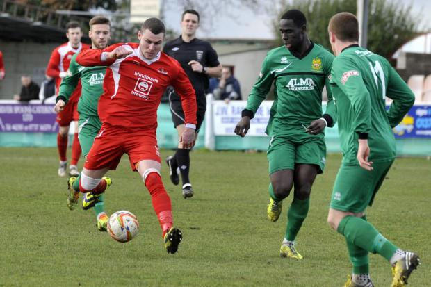 This Is Wiltshire: Frome Town's Ben Thomson gets on the ball against Hitchin Town last weekend