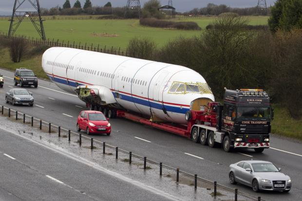 This Is Wiltshire: A specialised load transporter carrying the Airbus A321 aircraft fuselage on Sunday. Picture by Liam Daniels