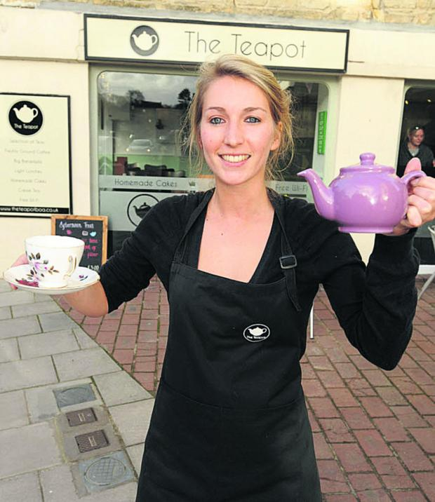 This Is Wiltshire: Becky Tyler outside the Teapot cafe in Bradford on Avon which was flooded on Christmas Eve