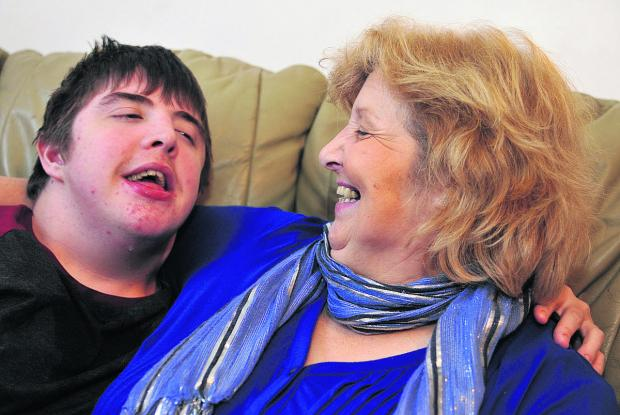 This Is Wiltshire: Teresa Brett with her 18-year-old son Robin, who has learning difficulties. Teresa set up the Swindon Children Without A Diagnosis charity