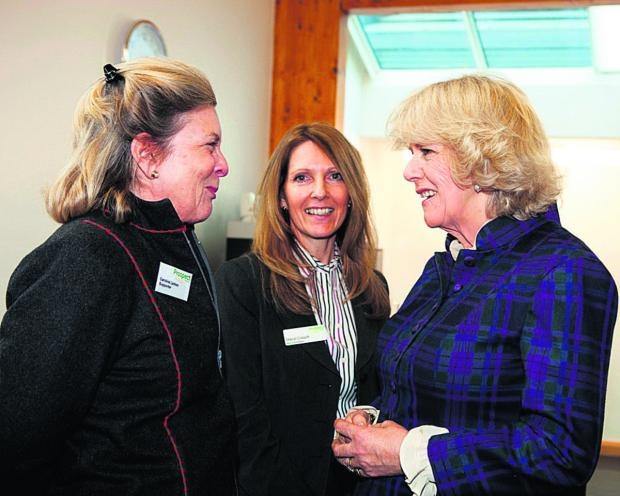This Is Wiltshire: Camilla on a visit to Prospect Hospice last year with Sheryl Crouch, head of fundraising (centre) and Caroline Larken, a Prospect ambassador