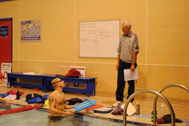 This Is Wiltshire: Phil Millard oversees Swindon Triathlon Club's swimming session at the Link Centre.