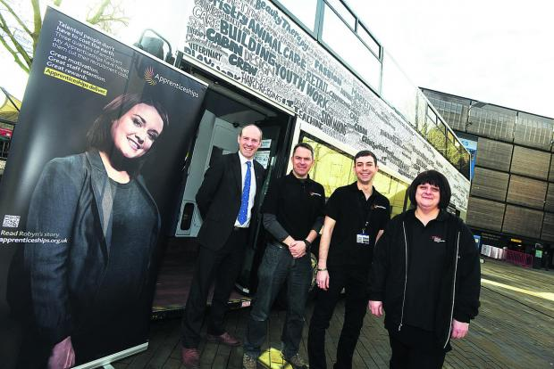 This Is Wiltshire: The Apprenticeship bus visits Swindon,  giving people advice on apprenticeships. Pictured are, left to right, MP Justin Tomlinson, Steve Jenkins, Rob Boreham-Fish and Sally Timmins