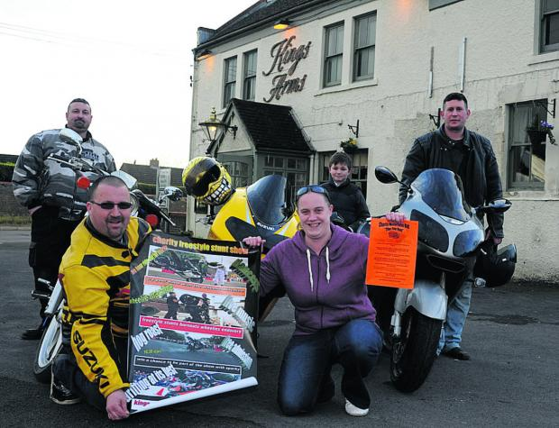 This Is Wiltshire: Mike and Megan Hayward display posters while from left, Martin Chalk, Mike's son Leon and  fellow biker Simon Hardwick at the Kings Arms in Hilperton