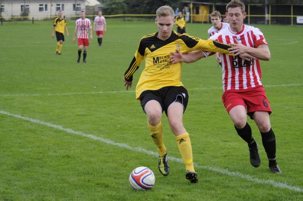 This Is Wiltshire: Dan Kovacs (yellow) was the hat-trick hero for Melksham Town last night