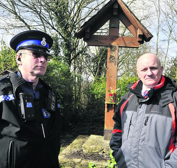This Is Wiltshire: PC Richard Gardner and PCSO Andrew Maclachlan at the Wingfield war memorial