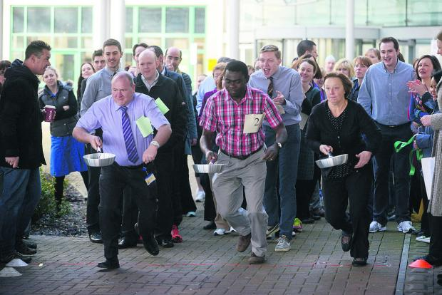 This Is Wiltshire: And they're off in GWH's pancake race raising money for Brighter Future