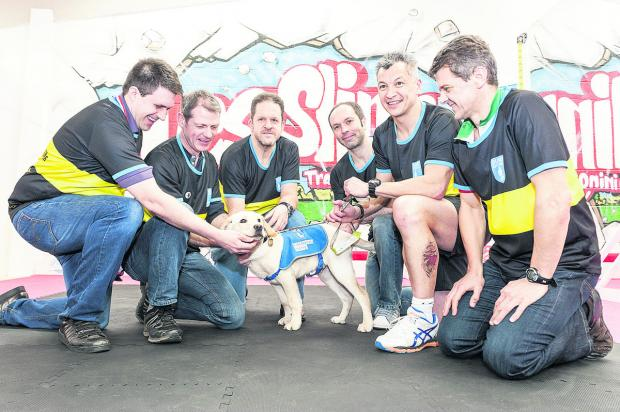 This Is Wiltshire: Les Slinn and his All Star team meeting the guide dog they helped to raise the money to buy for the first time. From left, Rob Sainsbury, Ady Mould, Liam Guest, Froome the puppy, Andy Willis, Les Slinn, Wayne Purkins