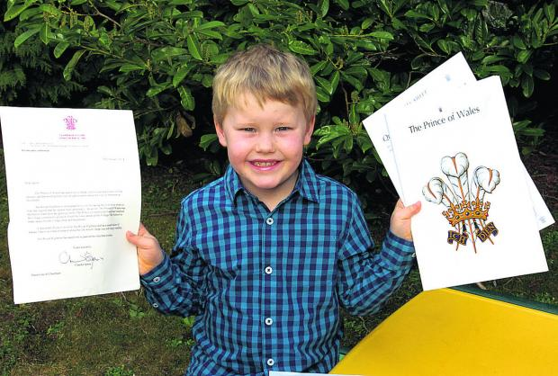 This Is Wiltshire: Jacob Cheetham with his letter and booklet from Clarence House after he sent a poem to Prince Charles