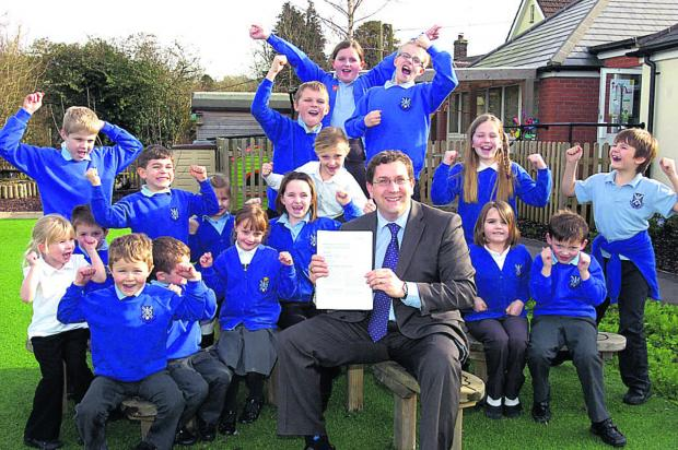 This Is Wiltshire: Headteacher Ashley Martin and pupils celebrate the Ofsted report