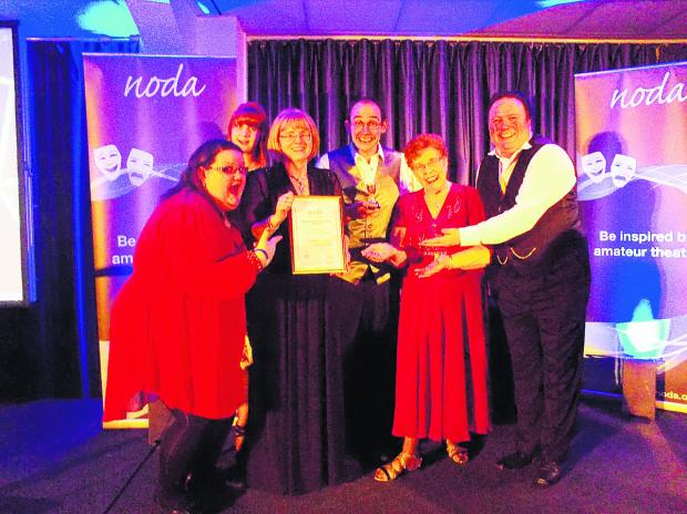 This Is Wiltshire: Wootton Bassett Light Operatic Society receiving the South West District Achievement Award for Alice In Pantoland.  From left, assistant director Megan Crocker, writer Elle Smart, director Ros Vickers, chairman Mike Davies, president Sheila Dunn and vice-