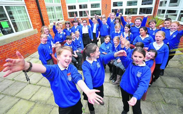 This Is Wiltshire: Pupils at Southfield Junior School, Highworth, who are singing at Wembley