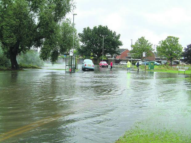 This Is Wiltshire: Residents have been asked to give their views to try to prevent scenes like this at the Coleview and Covingham Drive area by the River Cole in 2007