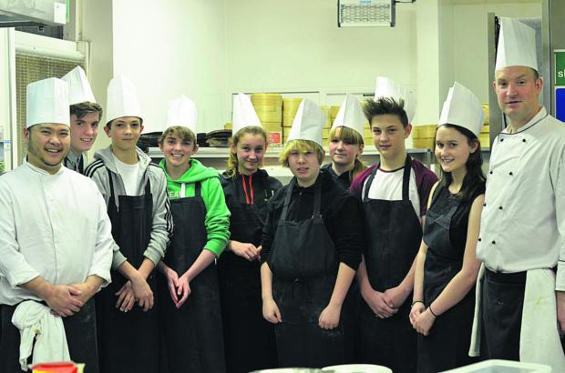This Is Wiltshire: The TGI 'team' during their day of learning the cooking skills at Sampans Restaurant at the Holiday Inn, with the chefs who provided the training