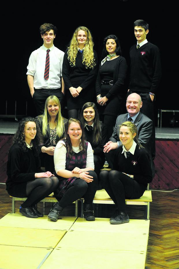 This Is Wiltshire: Back, from left,  Ellis, Louise, Taylor-Jane Hancock of The Wardrobe in Devizes, and Jake; middle, English teacher Hayley Lacey, Holly, and headteacher Malcolm Irons; front, Nicole, Hannah and Issy            (dv1139)