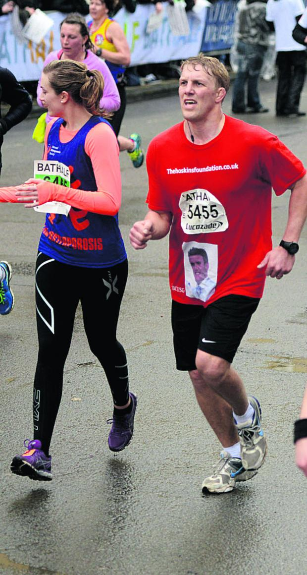 This Is Wiltshire: Lewis Moody with Laura Hoskins during the Bath Half Marthon