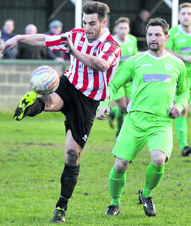 This Is Wiltshire: Devizes Town's Jamie McLaughlin in possession during his side's defeat to Westbury United on Saturday