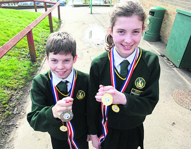 This Is Wiltshire: Conor Irwin and sister Ciara, with their medals
