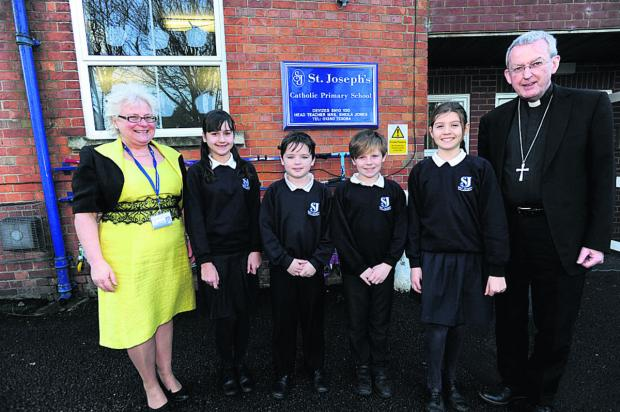 This Is Wiltshire: Headteacher Sheila Jones and the Rt Rev Declan Lang, Bishop of Clifton, with pupils from St Joseph's