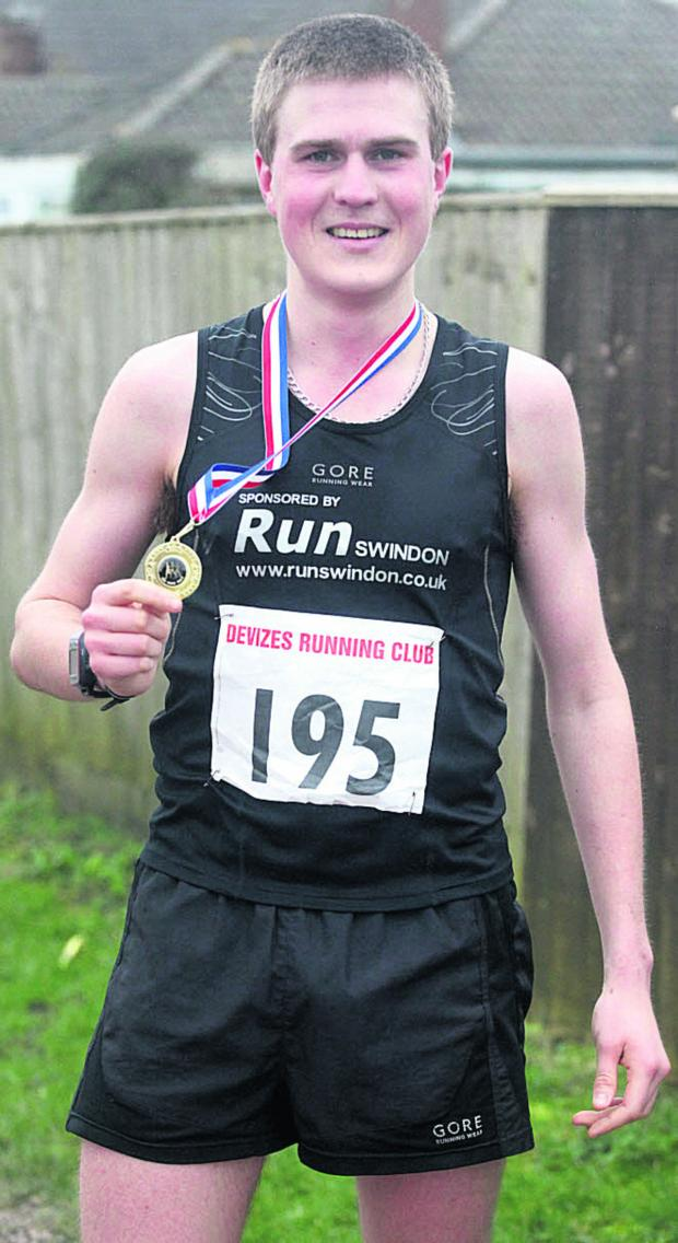 This Is Wiltshire: Race winner Simon Nott shows off his victor's medal