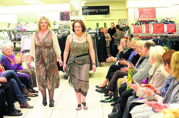 This Is Wiltshire: Chloe Buckle and Viv Shephard showcase the Bonmarché spring fashions during the store's fundraising catwalk night 	                                  (dv1136) By diane vose