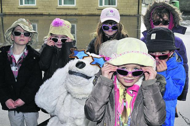 This Is Wiltshire: Richard Craft of Climate Friendly Bradford as Solar Polar the bear with Fitzmaurice School pupils Lydia, Thomas, Charlotte, James, Mollie and Freja