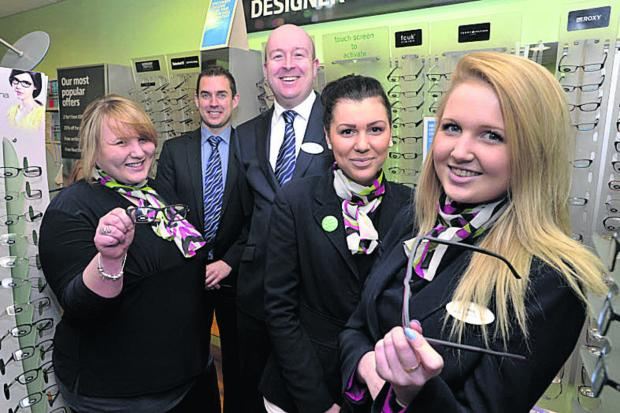 This Is Wiltshire: Specsavers apprentices, from left, Lacey Gibbs, Megan Price and Emily Spencer with Trowbridge Specsavers director Stephen Auty                                         Photo: Glenn Phillips (49193)