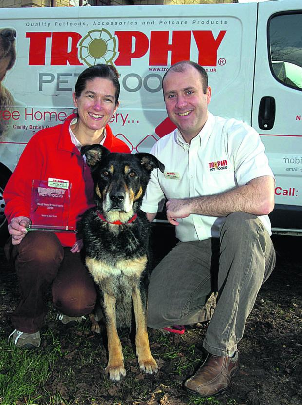 This Is Wiltshire: Award-winning Trophy Pet Foods franchisees Matthew and Jenny Snell with their ageing mongrel dog, Morse
