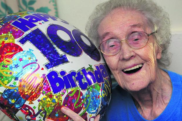 This Is Wiltshire: Edna Cook celebrating her birthday two years ago as a sprightly 100-year-old