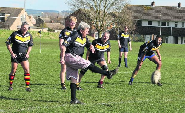 This Is Wiltshire: Jim Panting kicks off the charity rugby game in aid of Fatboys cancer charity at Swindon Rugby Club's ground