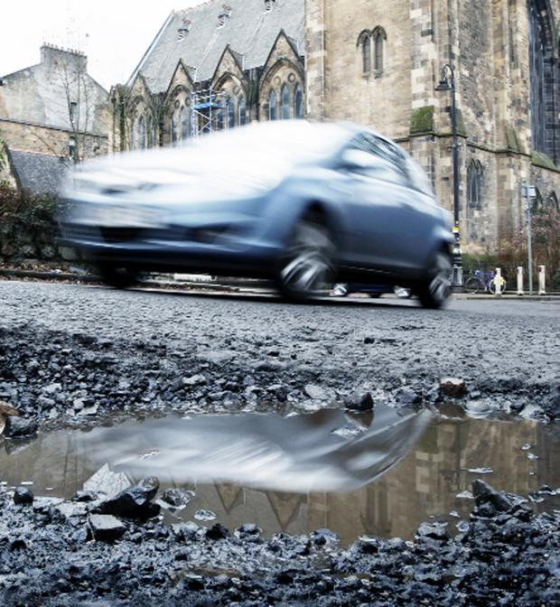 This Is Wiltshire: Wiltshire Council start to fix the roads badly damaged by the recent heavy rains