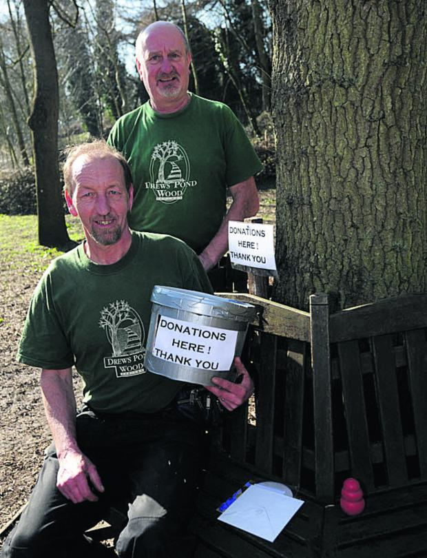 This Is Wiltshire: Volunteers group leader Stuart Hislop, seated, with  volunteer John Bate and appeal collection buckets  				          (dv1152) By diane vose