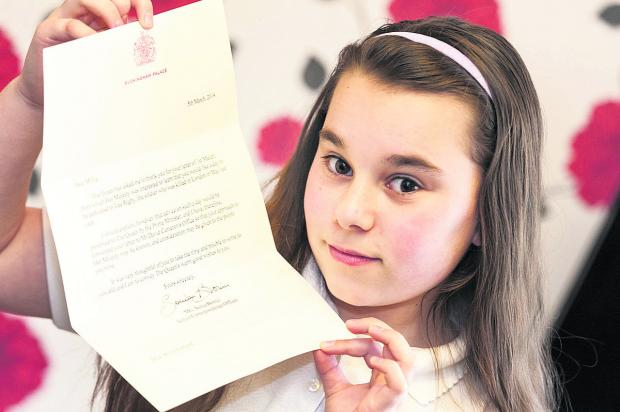 This Is Wiltshire: Millie Garland with her letter from the Queen