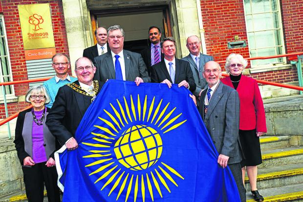 This Is Wiltshire: Swindon council participating in the raising of the Commonwealth Flag which is going to be a national event across the country. Pictured Mayor Nick Martin, Coun David Renard, Gavin Jones and deputy Lieutenant of Wiltshire William John Fishlock with member