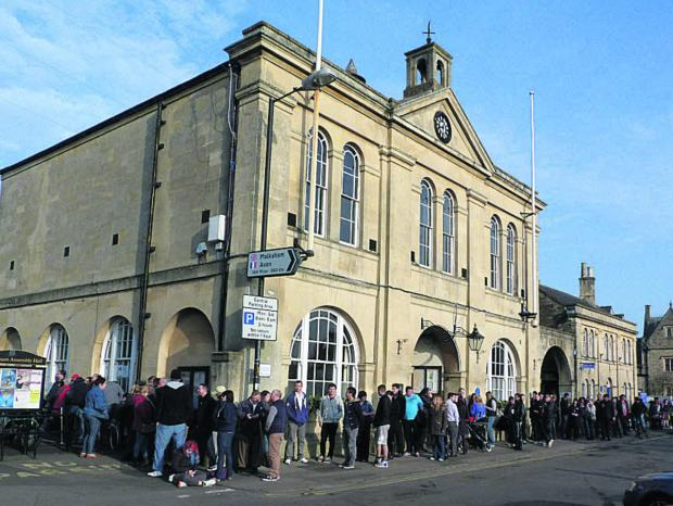 This Is Wiltshire: The queues outside the Town Hall this morning