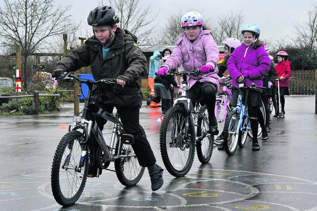 This Is Wiltshire: Children at the Mead Community Primary School rode, scooted and skated on Friday to raise money for the Friends of the Mead