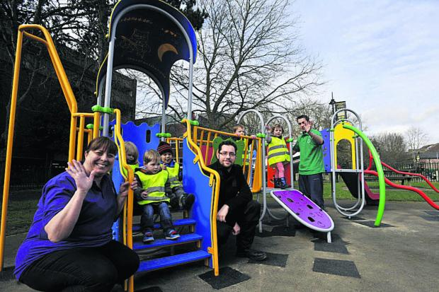 This Is Wiltshire: Carl Triggs, centre, of Trowbridge Town Council with Helen Pay, left, and youngsters from Little Movers Pre-School in Trowbridge Park               (49206)