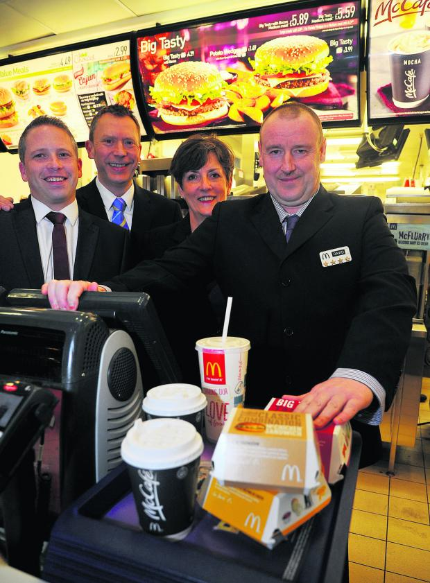 This Is Wiltshire: David Boote got a job at McDonalds through SEQOL. He has now earned his four employee star from the company. Pictured, left to right, are Neil Laybourne, manager, Paul Booth, franchisee, Ann King, SEQOL, and David