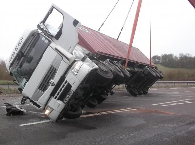 This Is Wiltshire: An overturned lorry along the A36 at the Deptford slip road westbound junction yesterday