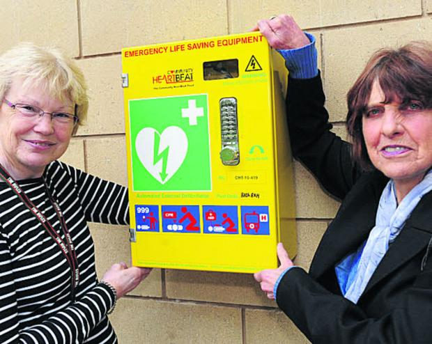 This Is Wiltshire: Maryrose Mantle and Coun Helen Osborn with the defibrillator put in place at the Civic Centre, Trowbridge, last year. More will be provided in Wiltshire soon