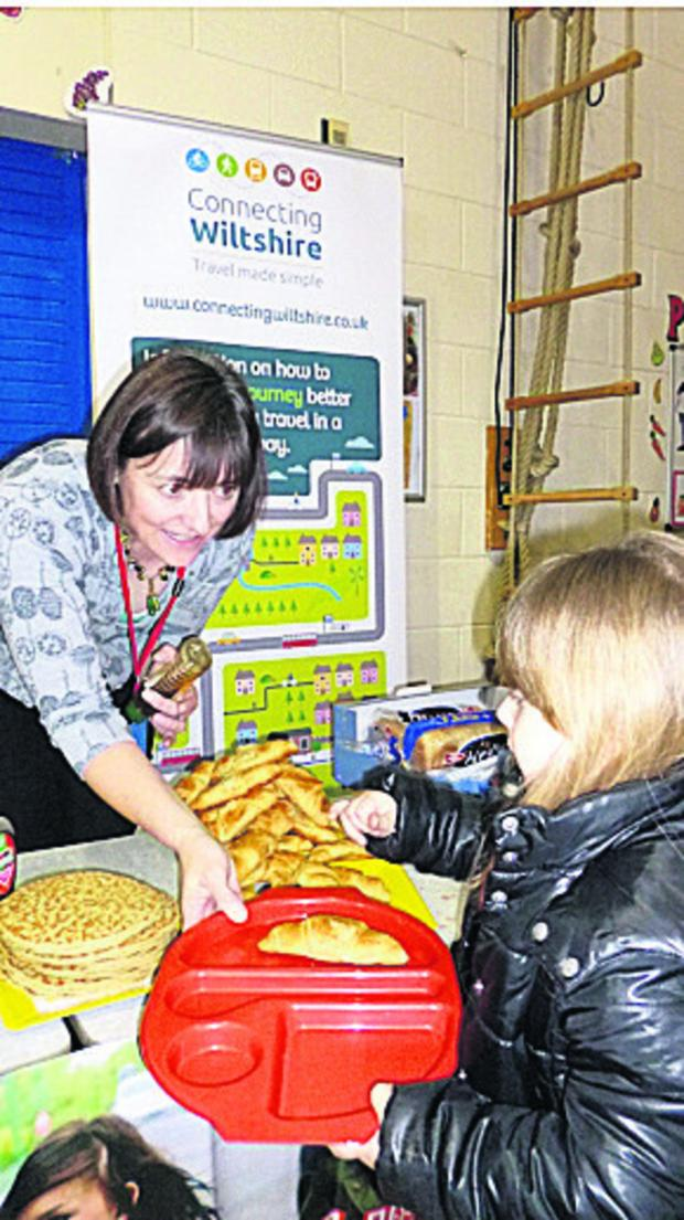 This Is Wiltshire: School governor Tracey Broadway hands out breakfasts at Queens Crescent School, Chipp