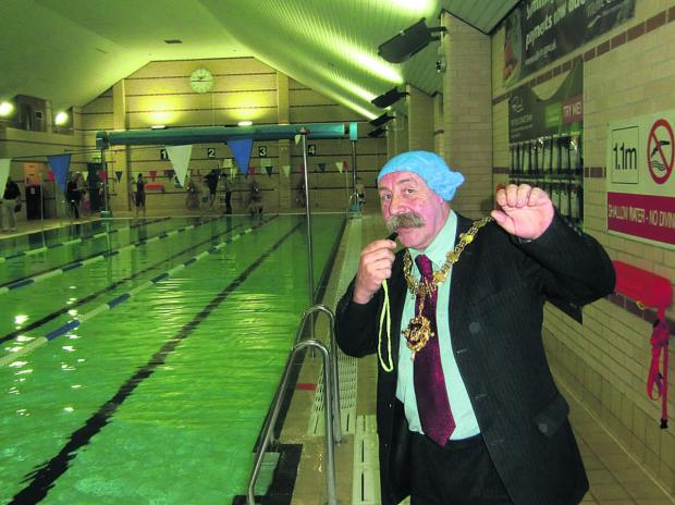 This Is Wiltshire: Devizes Town Mayor Pete Smith poised to blow the whistle to start this year's Swimathon organised by the Lions Club