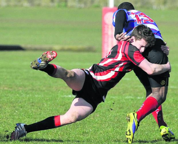 This Is Wiltshire: Bradford's Dan Bright gets to grips with Pewsey's Sikele Ratubuli on Saturday