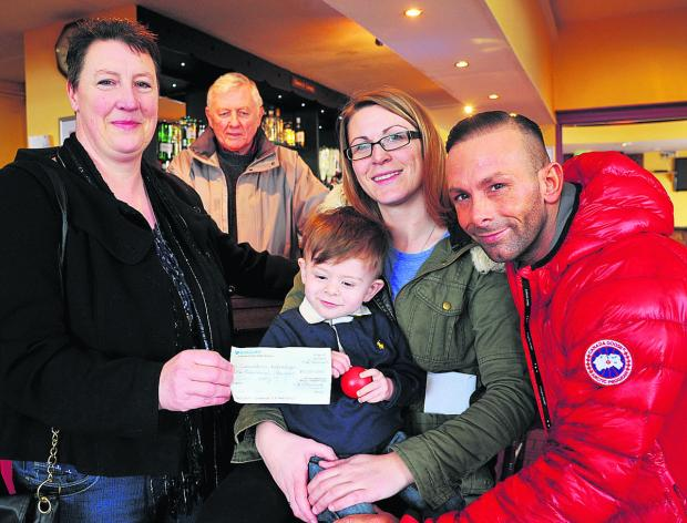 This Is Wiltshire: SEBASTIAN Murtough was all smiles at The Deers Leap pub yesterday as his family received more than £3,000 in donations from Penhill fundraisers and Walcot Charity Shop. The 20-month-old is battling cancer. He is currently recovering from a serious operat