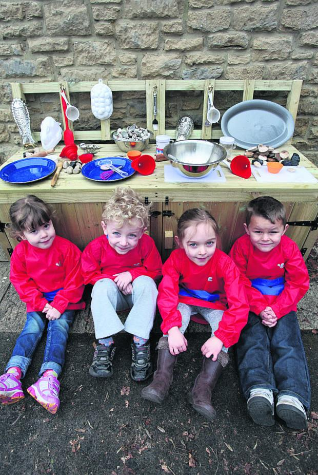 This Is Wiltshire: Crudwell Pre-School youngsters Sophia, Aidan, Sasha and Jaq show off their new mud kitchen