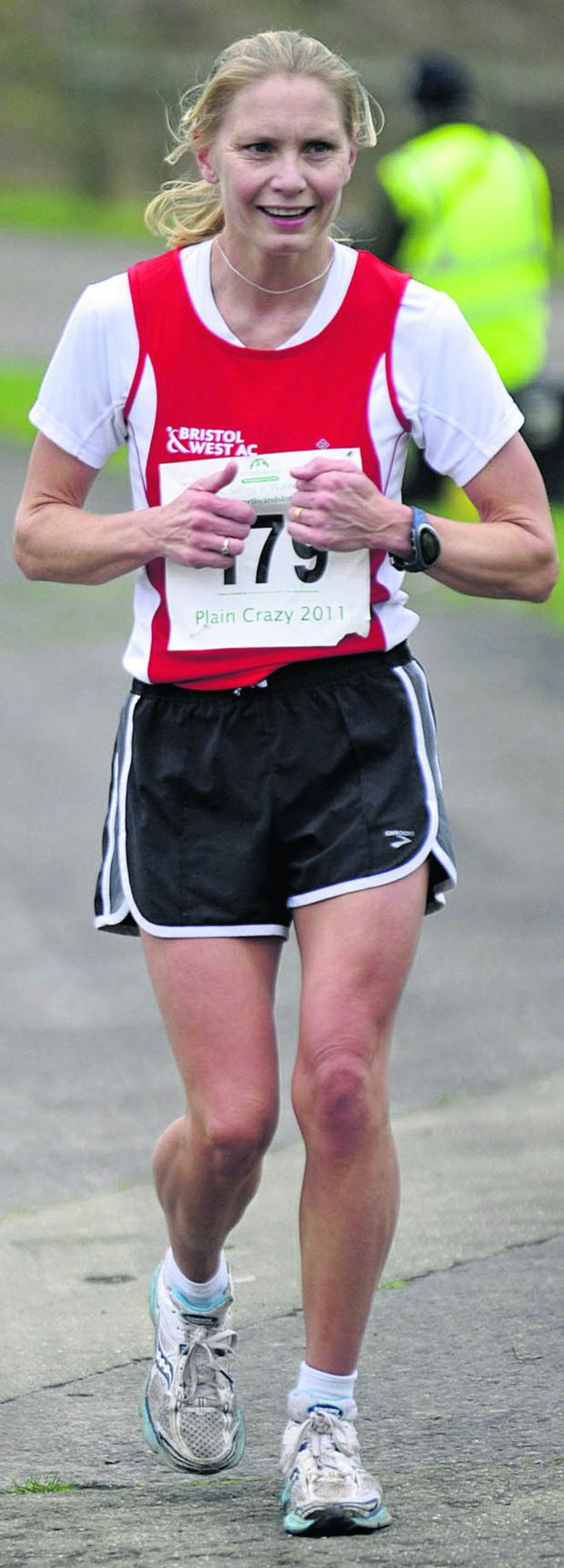 This Is Wiltshire: Amy Chalk was the first female finisher home in the Castle Combe Half-Marathon