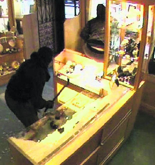 This Is Wiltshire: CCTV images taken during a smash and grab robbery at Deacon & Son jewellers in Marlborough last September