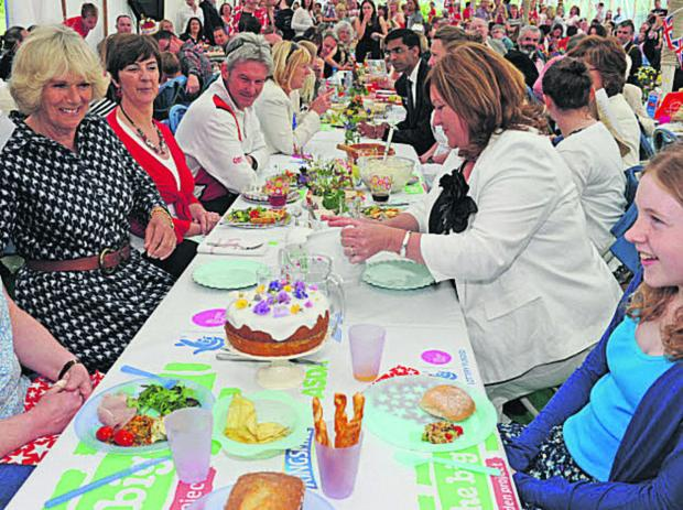 This Is Wiltshire: The Duchess of Cornwall enjoys the Big Lunch at Paxcroft Mead, Trowbridge, last year