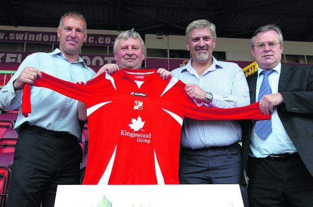 This Is Wiltshire: Kingswood Construction sponsored Swindon's Town's shirt in 2007. Mark Groves is pictured, left, with Kingswood's Brendan Mitchell (second right), showing off the new shirt with Paul Sturrock and Martyn Starnes (right) at the County Ground